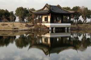 chinese hut and reflection in yangtze